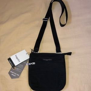 New Baggallini cross body bag Adj strap. New tags